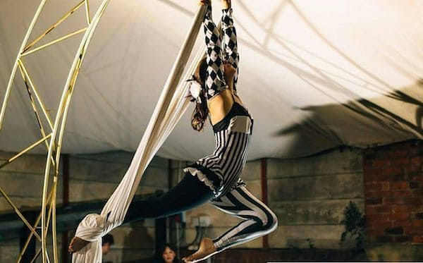 Aerial trapeze artist performing in the big top