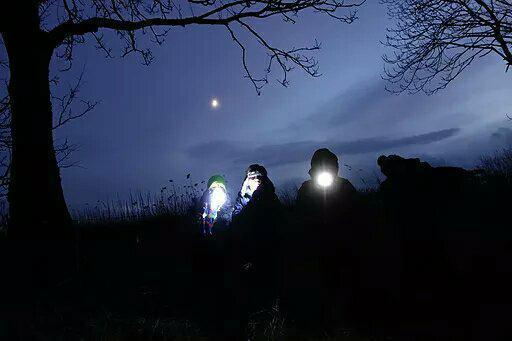Branch out Forest school - image of children attending at night with headtorches