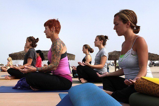 Women doing yoga seated